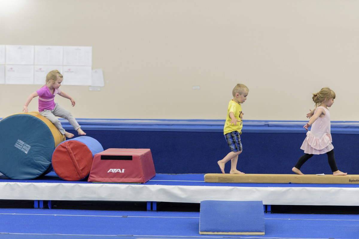 Kids walking on beam