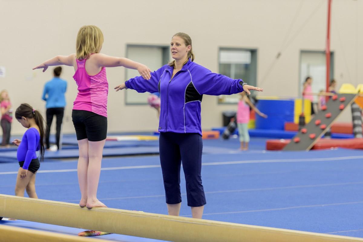 coach teaching student