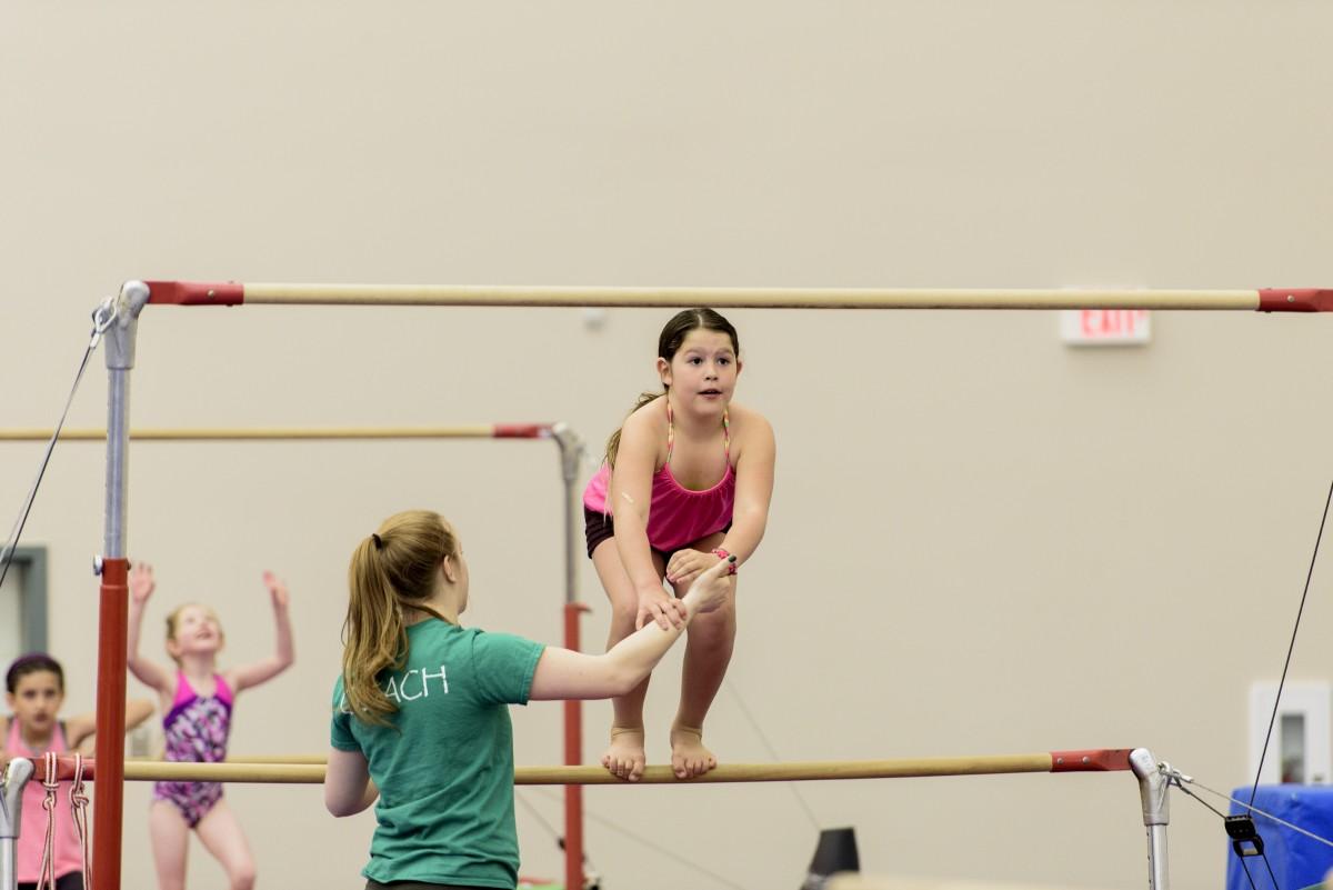 Girl balancing on a beam